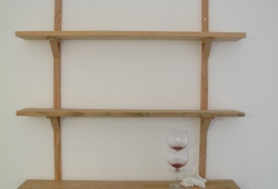 Nothing Happens fig. 7 (Stacking wine glass on wooden shelf)